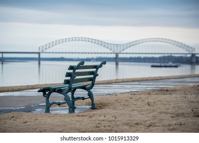Take a seat along the Mississippi River in Memphis Tennessee and enjoy the view of the river and I-40 bridge.