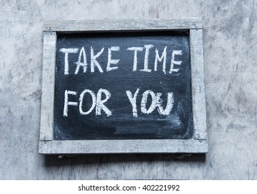 Take time for you - handwritten on a chalkboard