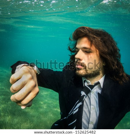 Take your business everywhere. Businessman Underwater watching time.Remote Business.
