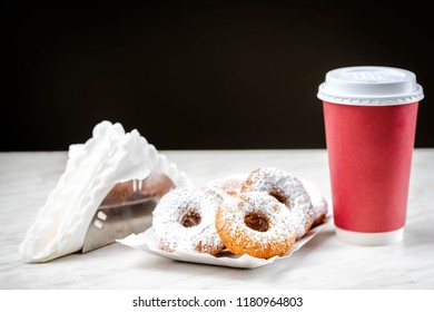 Takeaway coffee and donuts - a quick snack on the way,