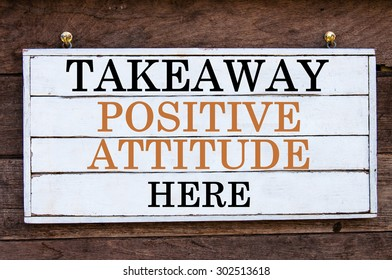 Takeaway Positive Attitude Here Inspirational message written on vintage wooden board. Motivation concept image