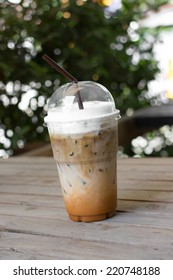 take-home cup of ice coffee on table.