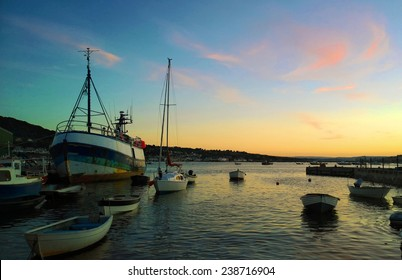 Taken 2014 boats of various types in teignmouth looking out across the teign estuary, pleasrue fishing and trade related boats mast sunny lovely sky