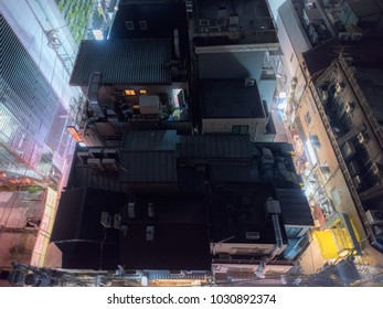 Taken fro the rooftop, view of a building by night in Tokyo, Japan. Social science fiction movie mood.