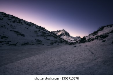 Taken at the mountain lake Partnun in the Swiss Alps during the morning hours at sunrise. The entire area is covered by snow.