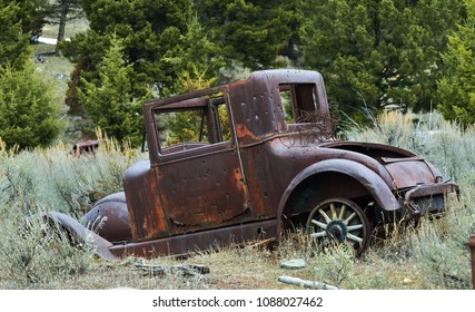 Taken near in and around the former mining town of Elkhorn, Montana. Abandoned car sits in weeds near the old town site.