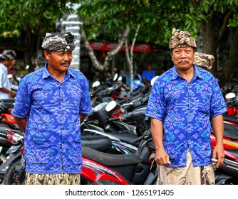 Taken on 20th September 2012 in Ketewel, Bali, Indonesia. Local Balinese men in the village of Ketewel in Bali prepare for a ceremony.