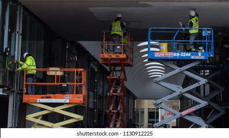 Taken on 23rd March 2017 in Oxford UK.  Colour image of three scissor lifts being used to build a shopping centre.