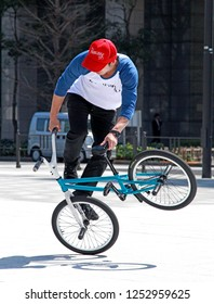 Taken on 29th March 2012 in Tokyo, Japan. A Japanese BMX rider performs tricks on a public square in the middle of the commercial area in Tokyo.