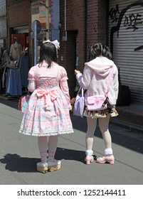 Taken on 8th April 2012 in Harajuku, Tokyo, Japan. Two dressed up girls in Harajuku wearing pink Lolita style outfits and make up.