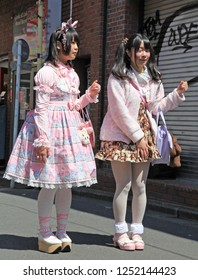 Taken on 8th April 2012 in Harajuku, Tokyo, Japan. Two dressed up girls in Harajuku wearing pink Lolita style outfits with accessories and make up.