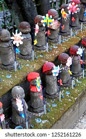 Taken on 8th April 2012 in Tokyo, Japan. The Jizo statues in the Garden of Unborn Children at Zojo-ji Temple in Tokyo represent souls of unborn children who died by stillbirth, abortion or miscarriage