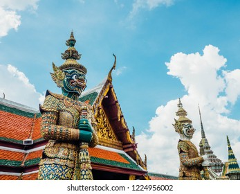 Taken on October 15, 2018 in Bangkok, Thailand Tossakan giant green skin and Giant Sahassadeja skin white body guarding the western gate of the south bank of the base of Phra Sri Ratana Chedi.