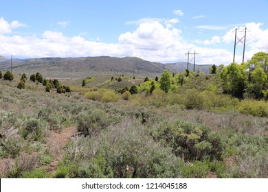 Taken from Soldier Summit facing US highway 6, with sagebrush, cedar trees, pines and quaking aspen, and power poles in the distance