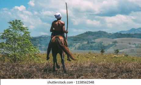 Taken in Wanokaka Hill in Sumba, Indonesia in September 13, 2016.  A man with his horse before doing a Pasola event. Pasola is a mounted spear-fighting competition from western Sumba, Indonesia.