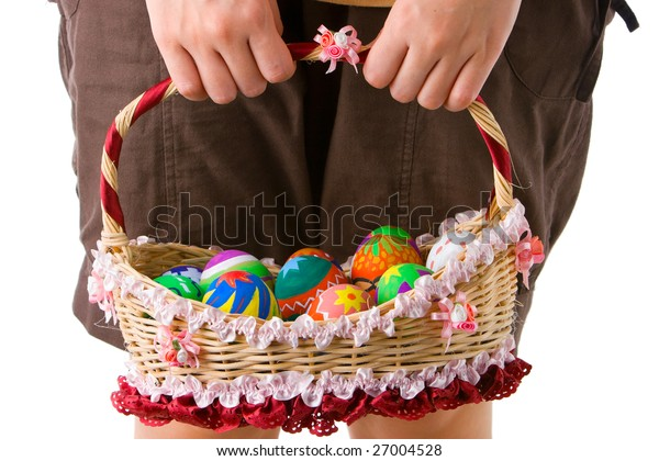 Taken when the basket full of colored Easter eggs were hold.
