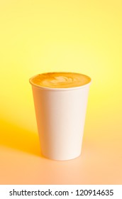 Take-out cappuccino in cardboard cup