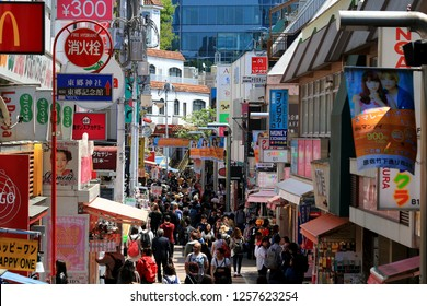 Takeshita street in Harajuku, Tokyo, Japan 04/10/2018 Takeshita street crowded with tourists is a center of Japanese sub culture where individual vintage clothing stores and cosplay shops gather