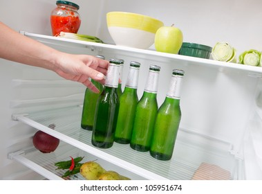 Taking beer from a fridge