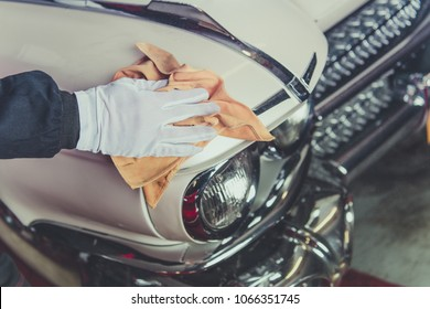 Taking Care of Classic Car. Passionate Vintage Cars Collector Cleaning One of His Vehicle. Closeup Photo.