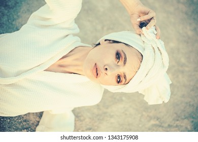 Taking care of herself. Skincare at spa. Pretty woman wear bath towel on head. Young woman in bathing gown. Skincare model after spa bath. Beauty salon. Beauty routine and hygiene care. Bathing habit.