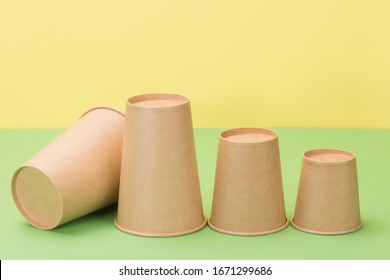 Taking care of nature and the concept of recycling. Paper tableware in yellow and green background.