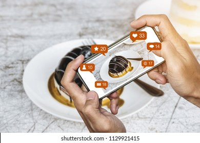 Taking dessert photograph by mobile smart phone, and sharing on social media, social network with notification icons