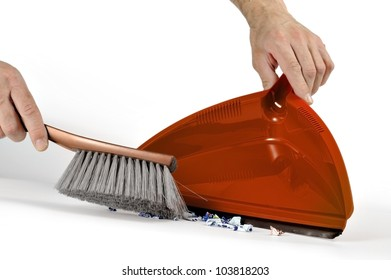 taking the dirt with brush and dustpan