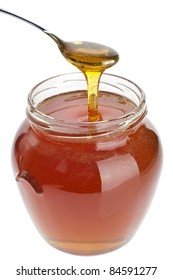 Taking the honey with a spoon from the jar