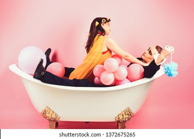 Taking long luxurious bath. Couple of mime man and woman enjoy bathing. Beauty routine and personal hygiene. Hair grooming routine. Couple in love in bath tub. Bubble bath day. Bathing hygiene habits.