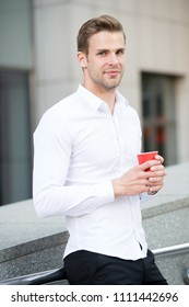Taking moment enjoy day. Man well groomed white shirt drinks coffee urban background. Businessman relaxing with coffee during lunch time. Guy handsome attractive office worker relaxing outdoor.