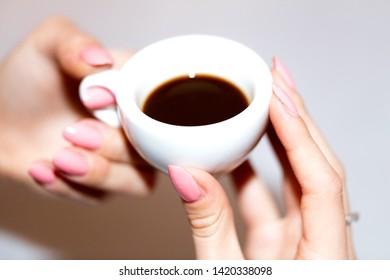 Taking the neapolitan coffee in ceramic cup