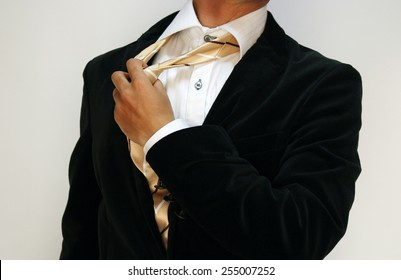 Taking off his tie Resignation from too much stress
