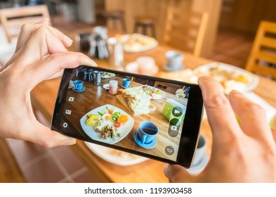 taking photo at breakfast on table