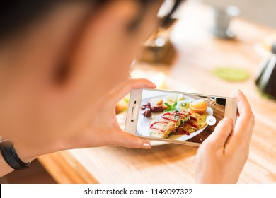 taking photo at morning breakfast on table
