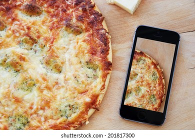 Taking photo of pizza with smartphone