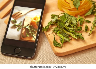 Taking photo of raw pasta with smartphone