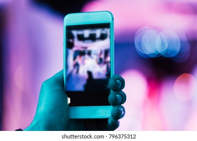 taking a photo with a smartphone at the club