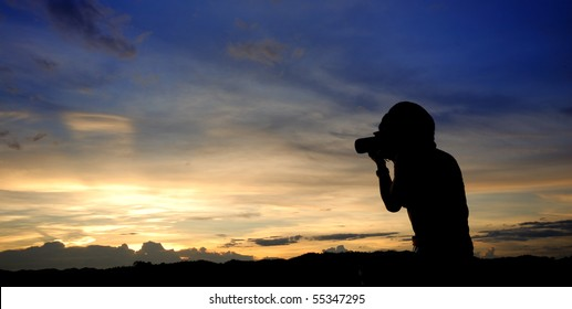 taking photograph of sunset