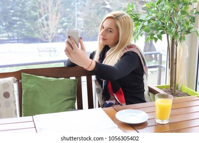 Taking photos in cafe.