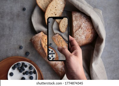 TAKING A PICTURE OF FRESH BREAD