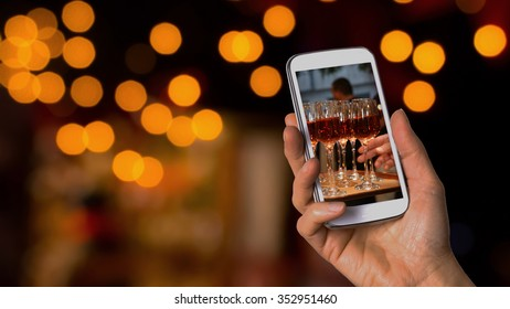 Taking picture of wine glasses during wedding reception
