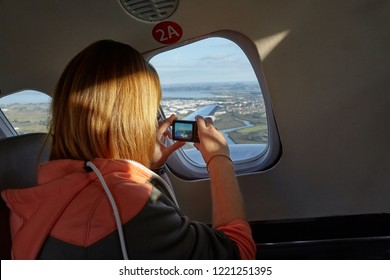Taking pictures throught the window of a small propeller plane