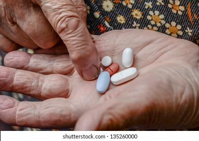 taking pill from palm