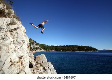Taking A Risk A young man jumps from a cliff into the sea!