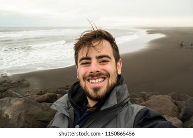 Taking a selfie at a black sand beach