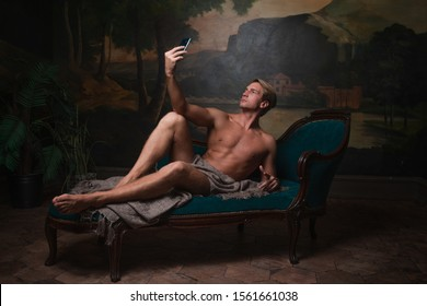 Taking selfies, social media addiction, concept. A funny remake of the creation of Adam, technology and modernity in the style of Renaissance paintings
