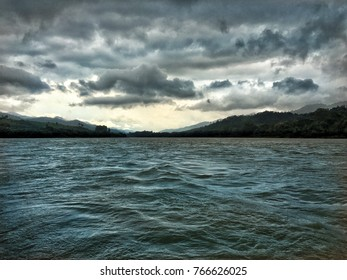 Taking a slow boat on the Mekong when a storm starts rolling in