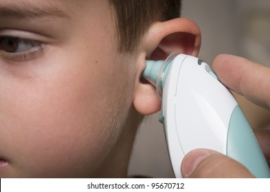 Taking temperature using in ear thermometer