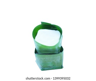 Tako Sago wrapped in banana leaves isolated white background